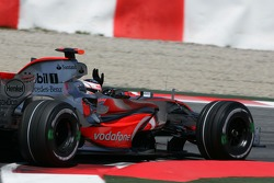 Fernando Alonso, McLaren Mercedes, MP4-22, waves to the fans