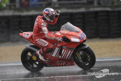 Third place Casey Stoner celebrates