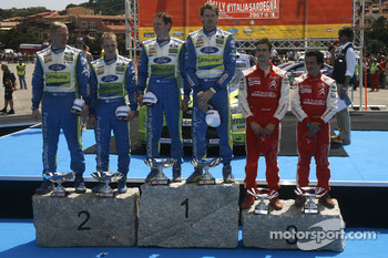 Podium: rally winners Marcus Gronholm and Timo Rautianen, second place Mikko Hirvonen and Jarmo Lehtinen, third place Daniel Sordo and Marc Marti