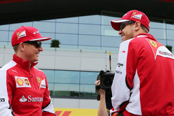 (L to R): Kimi Raikkonen, Ferrari with Sebastian Vettel, Ferrari on the drivers parade