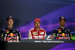 The post race FIA Press Conference,: Daniil Kvyat, Red Bull Racing, second; Sebastian Vettel, Ferrari, race winner; Daniel Ricciardo, Red Bull Racing, third