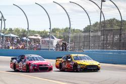 David Gilliland, Front Row Motorsports Ford and Kurt Busch, Stewart-Haas Racing Chevrolet