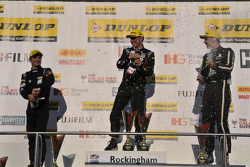 Colin Turkington, Jason Plato and Tom Ingram celebrate on the podium