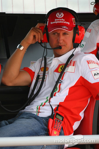 Michael Schumacher, Scuderia Ferrari, Advisor sitting on the pit wall