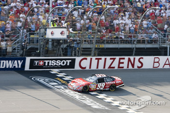 Carl Edwards takes the checkered flag