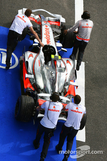 The car of Lewis Hamilton, McLaren Mercedes is returned to the pitlane after stopping on track