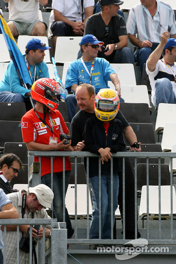 Fans of Michael Schumacher, Scuderia Ferrari, Advisor and Lewis Hamilton, McLaren Mercedes watch the action