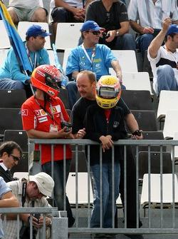 Fans of Michael Schumacher, Scuderia Ferrari, Advisor and Lewis Hamilton, McLaren Mercedes watch the action