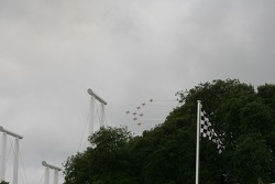 Red Arrows display in stormy sky