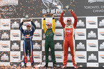 Podium: race winner Will Power with Neel Jani, Justin Wilson