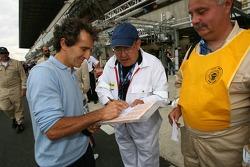 Alain Prost signs autographs