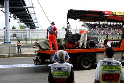 Lewis Hamilton, McLaren Mercedes, MP4-22, is returned to the pitlane