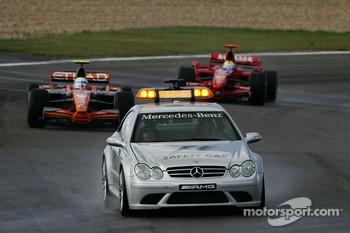 Markus Winkelhock, Spyker F1 Team, F8-VII and Kimi Raikkonen, Scuderia Ferrari, F2007 behind the safety car