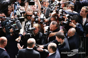 Ron Dennis, McLaren, Team Principal, Chairman, speaks to reporters outside the FIA Headquaters