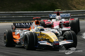 Giancarlo Fisichella, Renault F1 Team, R27 and Jarno Trulli, Toyota Racing, TF107