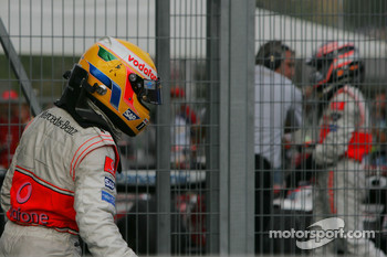 Race winner Lewis Hamilton, McLaren Mercedes, MP4-22 and 4th Fernando Alonso, McLaren Mercedes, MP4-22