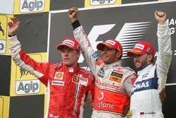 Podium: race winner Lewis Hamilton with second place Kimi Raikkonen and third place Nick Heidfeld