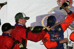 Podium: champagne for race winners Alex Gurney and Jon Fogarty