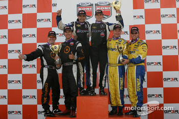 Podium: race winner Kuno Wittmer and Nick Wittmer, second place Karl Thomson and Billy Johnson, third place Trevor Hopwood and Adam Burrows