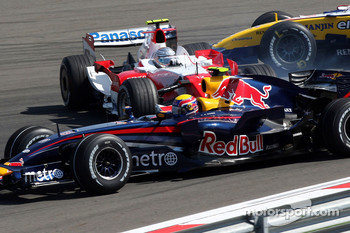 Mark Webber, Red Bull Racing, RB3 as Jarno Trulli, Toyota Racing, TF107 is sideways