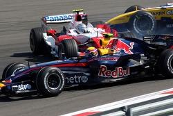 Mark Webber, Red Bull Racing, RB3 as Jarno Trulli, Toyota Racing, TF107 is sideways