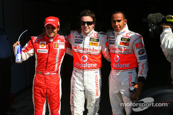 Pole winner Fernando Alonso with Felipe Massa and Lewis Hamilton