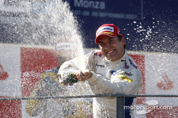 Timo Glock celebrates victory on the podium