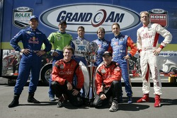 Grand Am Rolex Series past champions Terry Borcheller, Max Papis, Scott Pruett, Wayne Taylor, Max Angelelli and Jorg Bergmeister, and 2007 championship contenders Jon Fogarty and Alex Gurney pose with the championship trophy