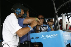 Salvador Duran and Chip Ganassi team members celebrate the pole position