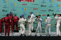 Podium: race winners Timo Bernhard, Marc Lieb, Romain Dumas and Marcel Tiemann, second place Christophe Bouchut, Patrick Simon, Tom Coronel and Duncan Huisman, third place Marc Basseng, Marc Hennerici, Frank Stippler, Dirk Adorf