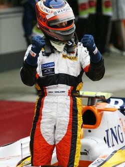 Heikki Kovalainen celebrates second place finish