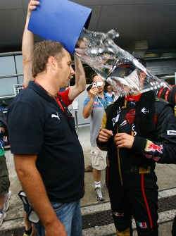 Vitantonio Liuzzi, Scuderia Toro Rosso is covered in water while talking to Gerhard Berger, Scuderia Toro Rosso, 50% Team Co Owner after he finished 6th in the race