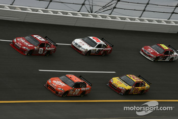 Tony Stewart and Dale Earnhardt Jr. lead a group of cars