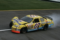 Billy Tanner drives his wrecked car on pit road