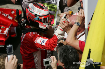 Race winner and 2007 World Champion Kimi Raikkonen celebrates with his team