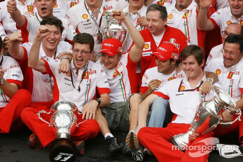 Ferrari team celebrations: race winner and 2007 World Champion Kimi Raikkonen celebrates with Felipe Massa, Jean Todt, Chris Dyer and Ferrari team members