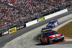 Juan Pablo Montoya leads a pack of cars