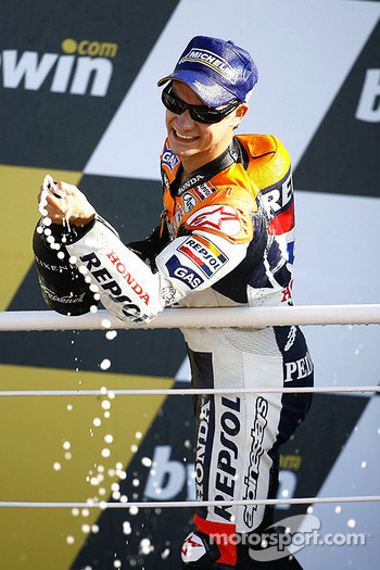 Podium: champagne for race winner Dani Pedrosa