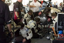 Minardi Team USA  team members replace the clutch on the car of Robert Doornbos
