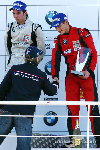 Podium: provisional third place Marco Witmann receives his trophy from Nick Heidfeld