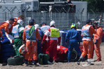 Safety crew members to rescue after the crash of Michael Schumacher
