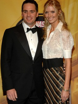 2007 NASCAR NEXTEL Cup Series champion Jimmie Johnson and wife Chandra smile for the cameras on the yellow carpet at the Waldorf=Astoria