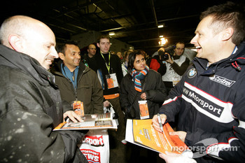 Andy Priaulx signs autographs