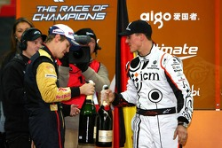 Michael Schumacher and Sebastian Vettel get the champagne on the podium