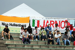 Fans in the grandstand and banners for Nico Hulkenberg, Sahara Force India F1 and Jarno Trulli