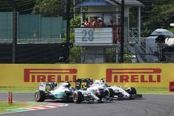 Nico Rosberg, Mercedes AMG F1 W06 and Valtteri Bottas, Williams FW37 battle for position