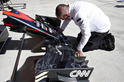 McLaren mechanic with front wing
