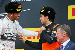 (L to R): Race winner Lewis Hamilton, Mercedes AMG F1 celebrates on the podium with third placed Sergio Perez, Sahara Force India F1
