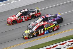 Clint Bower, Michael Waltrip Racing Toyota and Denny Hamlin, Joe Gibbs Racing Toyota and Kurt Busch, Stewart-Haas Racing Chevrolet