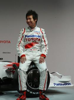 Kamui Kobayashi poses with the new Toyota TF108